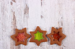 Stained glass gingerbread on old wooden background, christmas time Royalty Free Stock Images