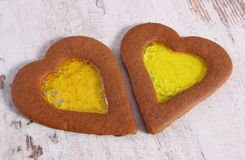 Stained glass gingerbread in shape of heart on old wooden background, christmas time Royalty Free Stock Photo