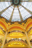 Stained Glass and Golden Balconies in Paris. Art deco architecture with stained glass and golden balconies in Galleries Lafayette Paris, France Royalty Free Stock Image