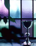 Stained Glass Grail. A chalice lighted from the stained glass window Royalty Free Stock Images