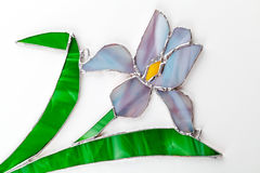 Stained glass hand-made iris flower on white. Background Stock Photo