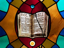 Stained Glass Holy Bible. Stained glass rendering of Holy Bible, horizontal Stock Photo