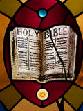 Stained Glass Holy Bible. Stained glass rendering of Holy Bible, vertical Royalty Free Stock Photography