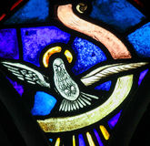 Stained Glass - Holy Spirit, symbolized by a white dove. Stained Glass in the Church of Tervuren, Belgium, depicting the Holy Spirit, symbolized by a white dove Stock Image