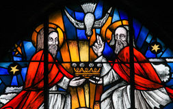 Stained Glass - the Holy Trinity. Stained Glass in the Church of Tervuren, Belgium, depicting the Holy Trinity - Father, Son and Holy Spirit royalty free stock photography