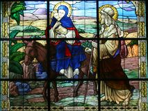 Flight to Egypt. Stained glass in the house Casa Nova, shows the Flight to Egypt in Bethlehem, Israel Stock Photos
