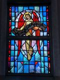 Stained Glass image of angel holding banner honoring Jesus. Taken at St Rita Church in New Orleans stock photography