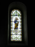 Stained glass inside church stock photography