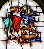 Stained Glass - Jesus Calls Four Fishermen to follow Him. Stained Glass window in the 15th Century Elzenveld Chapel in Antwerp, Belgium, depicting Jesus Calling Stock Photo