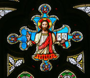 Stained Glass - Jesus Christ - Alpha and Omega. Stained Glass window in St. Vitus Cathedral, Prague, depicting Jesus Christ holding the bible with Greek Letters Royalty Free Stock Photography