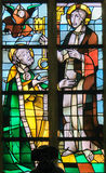 Stained Glass - Jesus Christ and Saint Peter. Stained Glass in the Church of Tervuren, Belgium, depicting Jesus Christ handing over the Keys to Heaven to Saint stock image