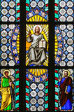 Stained Glass - Jesus holding the Holy Bible and saints Stock Images