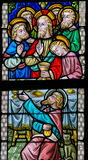 Stained Glass - Maundy Thursday. Stained Glass window in St Gummarus Church in Lier, Belgium, depicting Jesus and the Apostles at the Last Supper, with the Stock Image