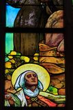 A stained glass mosaic window of religion church Stock Photos