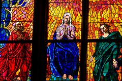 A stained glass mosaic window of religion church Stock Image