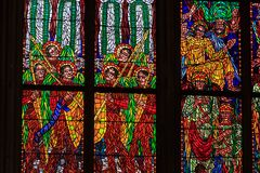 A stained glass mosaic window of religion church Stock Images