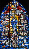 Stained Glass - Mother Mary. Stained Glass in the Church of Tervuren, Belgium, depicting Mother Mary and the Dogma of the Immaculate Conception royalty free stock photos