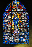 Stained Glass - Mother Mary. Stained Glass in the Church of Tervuren, Belgium, depicting Mother Mary and the Dogma of the Immaculate Conception royalty free stock photo