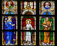 Stained Glass - Mother Mary, Jesus and Saint Joseph. Stained Glass window in the 15th Century Elzenveld Chapel in Antwerp, Belgium, depicting Mother Mary, Jesus Stock Photo