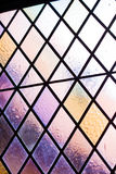 Stained glass with multi colored diamond pattern as background Royalty Free Stock Image