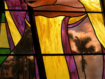 Stained Glass Palm. A palm tree is seen through a stained glass window in Hawaii Stock Images