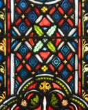 Stained glass patterns. Colourful stained glass on the window of a church Royalty Free Stock Photo