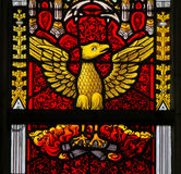 Stained Glass - Phoenix rising from the ashes royalty free stock photo