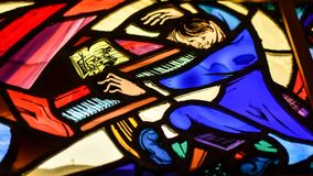 Stained Glass Pianist on Grand Piano Royalty Free Stock Image