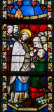 Stained Glass - Priest giving Holy Communion Stock Photography