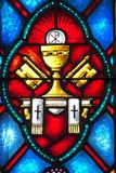 Stained Glass representation of the Catholic stock photography