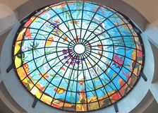 Stained glass roof at hotel. Colorful stained glass roof at a resort hotel at day light Stock Photo