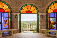 Stained glass room with view of outdoors Royalty Free Stock Images