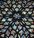 Beautiful stained glass rose window in Sainte-Chapelle Paris France. Stained Glass rose windows at Sainte-Chapelle a royal chapel in the Gothic style, within the Royalty Free Stock Images