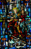Stained Glass in Rouen Cathedral - Joan of Arc. Joan of Arc captured by the Burgundians at the Siege of Compiegne & x28;1430& x29; on a stained glass in the Stock Photography