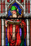 Stained Glass - Saint Ambrose. Church window in the Dom of Cologne, Germany, depicting Saint Ambrose, one of the four Latin Church Fathers Stock Image