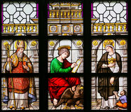 Stained Glass - Saint Augustine, John the Evangelist and Elizabe. Stained Glass window in the 15th Century Elzenveld Chapel in Antwerp, Belgium, depicting Saint Stock Photos