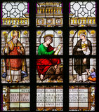 Stained Glass - Saint Augustine, John the Evangelist and Elizabe. Stained Glass window in the 15th Century Elzenveld Chapel in Antwerp, Belgium, depicting Saint Royalty Free Stock Photography