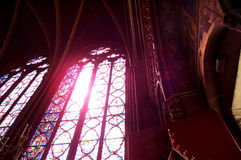 Stained glass in Saint Chapelle. Red flare through a stained glass window in the gothic church Saint Chapelle stock image