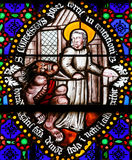 Stained Glass - Saint Conteste resists Satan Stock Image