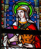 Stained Glass - Saint Elizabeth, Queen of Hungary. Stained Glass in the Church of Sablon in Brussels, Belgium, depicting Saint Elizabeth, Queen of Hungary, a Stock Photo