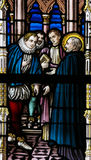 Stained Glass - Saint Francis Xavier and Martim Alfonso de Souza. Stained Glass window in St Gummarus Church in Lier, Belgium, depicting a meeting of Saint royalty free stock photography