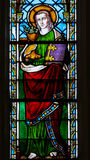 Stained Glass - Saint John the Evangelist. Stained Glass window in the Church of Braine-le-Chateau, Wallonia, Belgium, depicting Saint John the Evangelist Royalty Free Stock Photography
