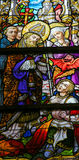 Stained Glass - Saint Livinus. Stained Glass window depicting an Exorcism by Saint Livinus, in the Cathedral of Saint Bavo in Ghent, Flanders, Belgium Stock Photography
