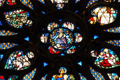Stained glass in Sainte Chapelle Paris. The sainte-Chapelle in Paris owes its fame to its stained-glass windows: 6,458 sq. ft of glass, of which two thirds are Stock Photo