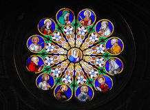 Stained glass saints. Stained glass window, with saints.  Shot at Santa Maria Sopra Minerva, in Rome Stock Photo