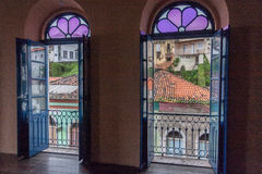 Stained Glass Sao Luis do Maranhao Brazil. Two windows with purple flower stained glass and the historical houses of Sao Luis do Maranhao, Brazil Stock Photo