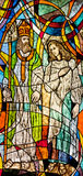 Stained glass showing Bishop Nicholas and believer. Stained glass showing bishop saint Nicholas and believer Royalty Free Stock Photo