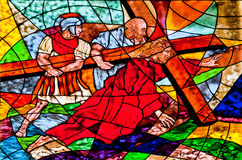 Stained glass showing Jesus falls under the Cross Royalty Free Stock Photos