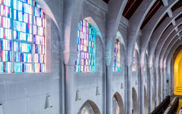 Stained Glass Between Stone Arches Stock Photo