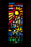 Stained Glass Sun. A stained glass window in the Catholic Church of the Annunciation depicts a sun and flowers Stock Photos